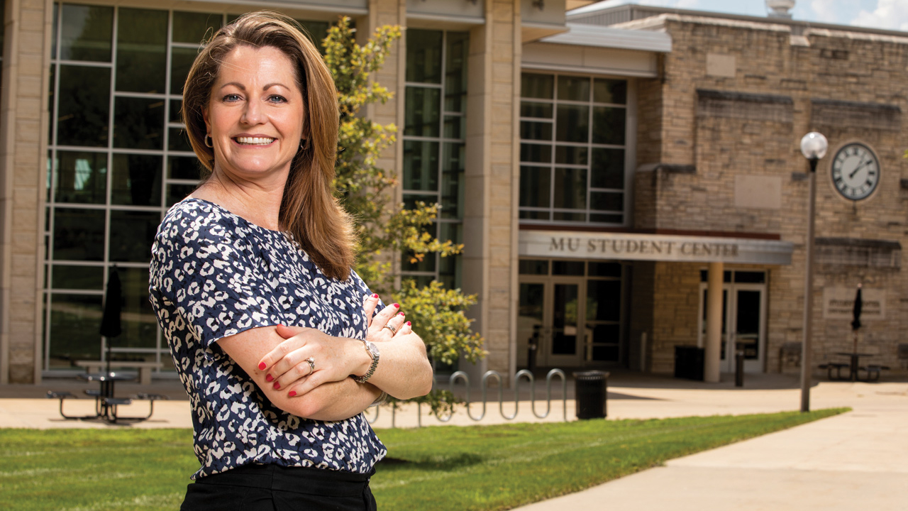 lori fox smiling in front of student center