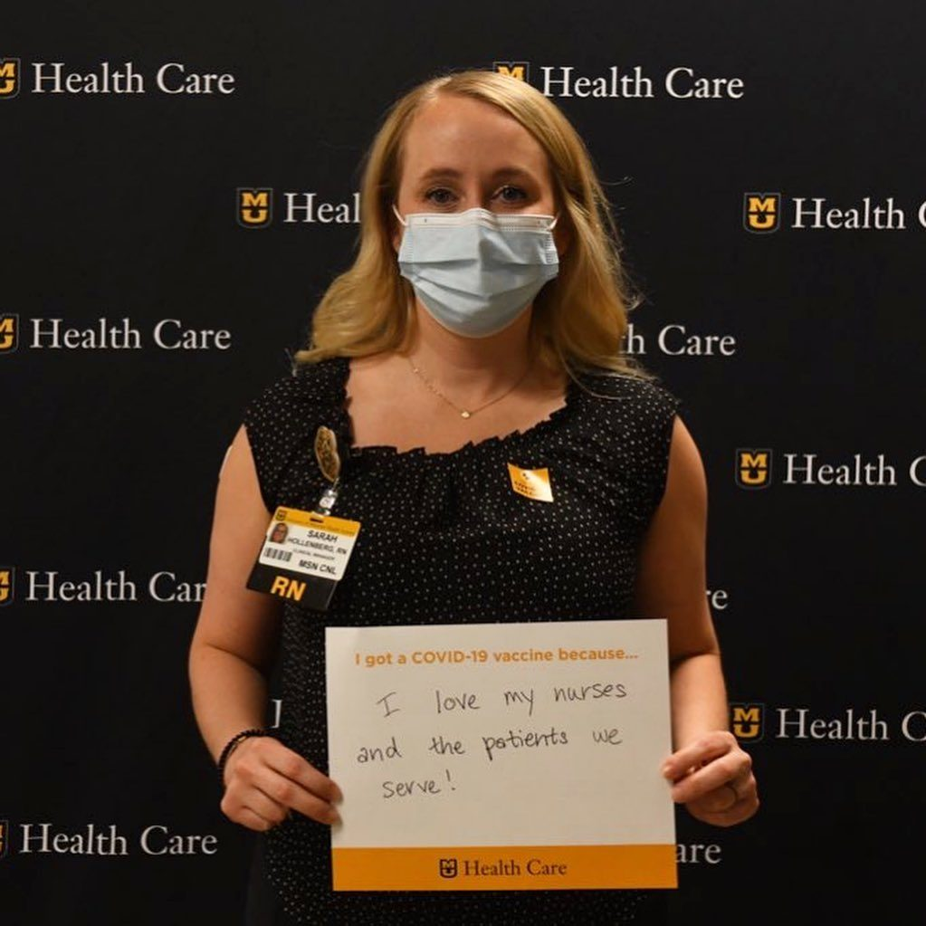 person holding a sign explaining why they got the vaccine