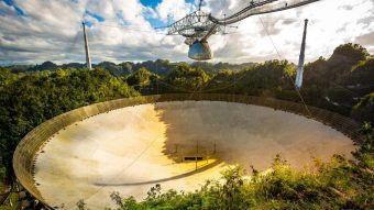 This is a picture of the Arecibo radio telescope.