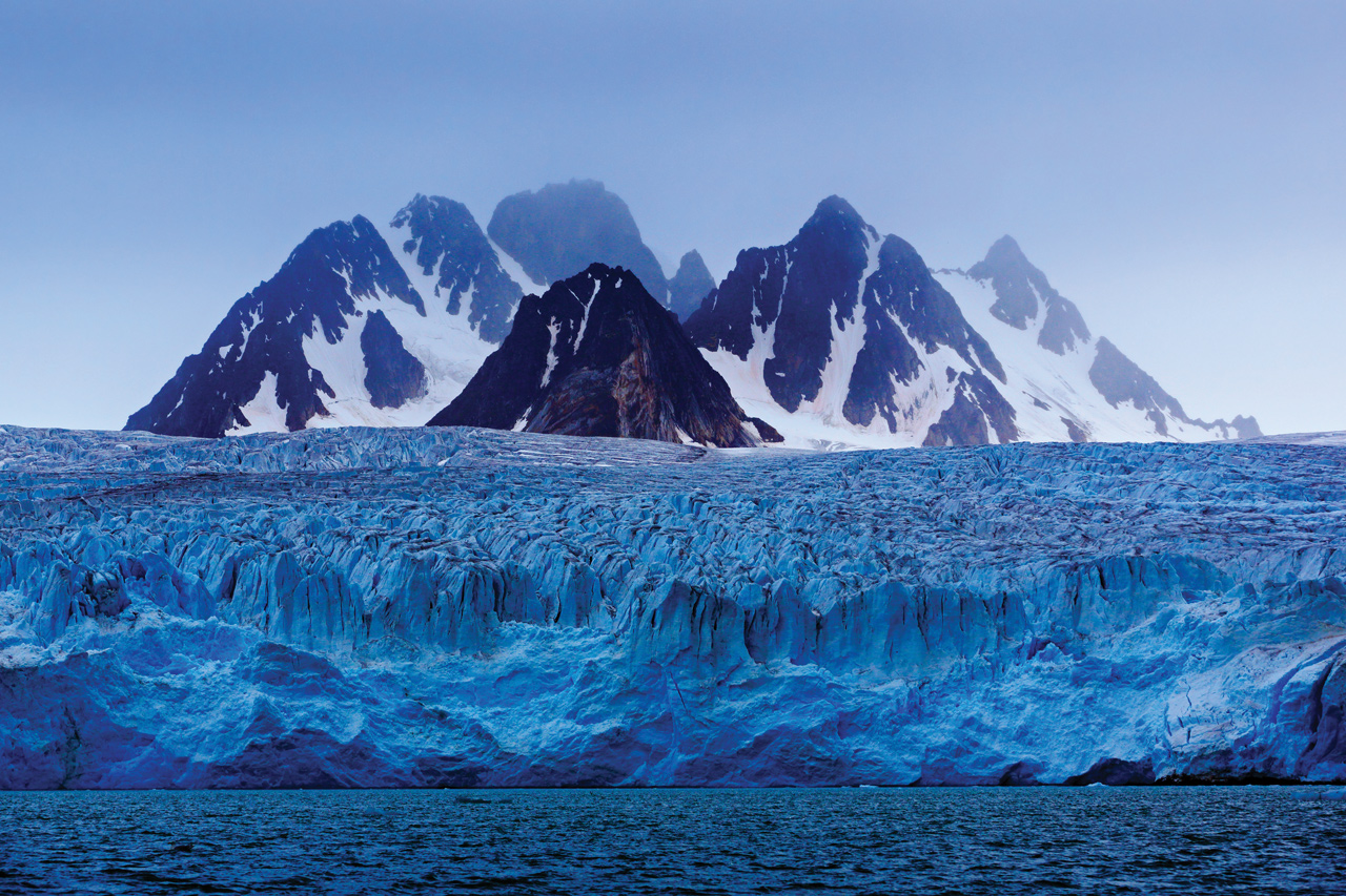 glacier with mountain in background