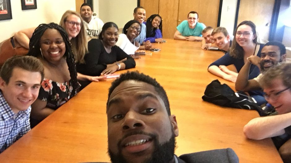 Speaker Damon Jones meets with a group of ECON 1014 students after class. Note: This photo was taken prior to COVID-19.