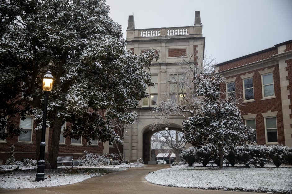 Snow on the ground and trees outside the Journalism School archway between Neff Hall and Walter Williams Hall