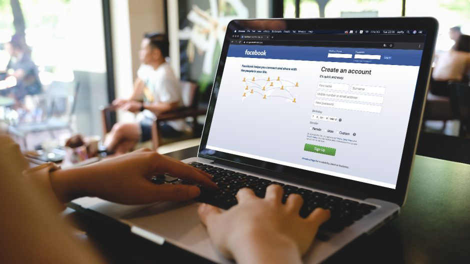 person using laptop with Facebook login screen