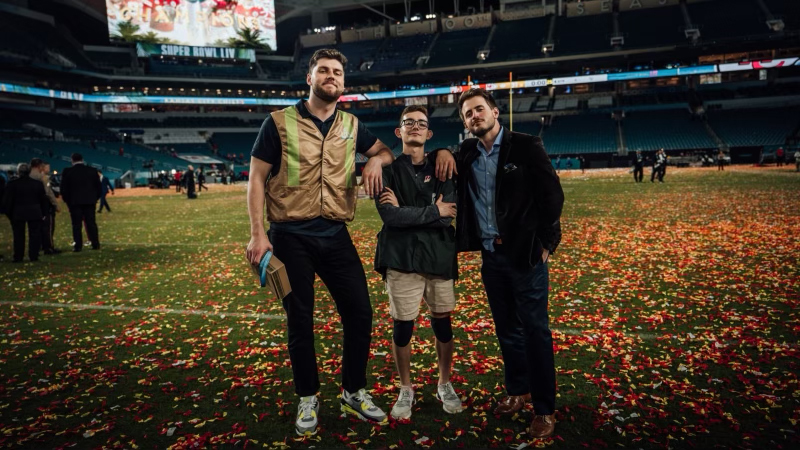 three men at the super bowl with confetti on the ground