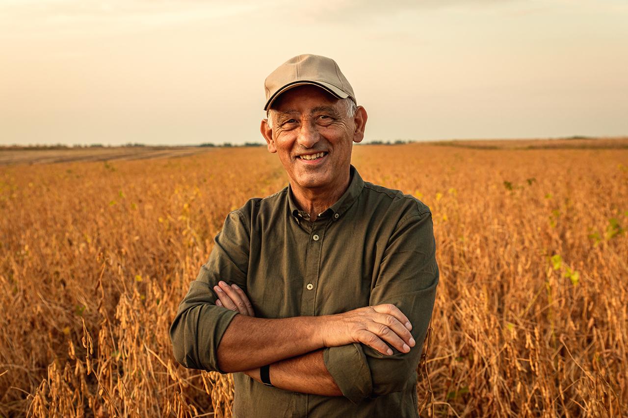 farmer in a field smiling