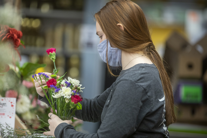 Amara Limberis, a junior Health Sciences major from Eden Prarie, Minnasota, arranges flowers in a vase.