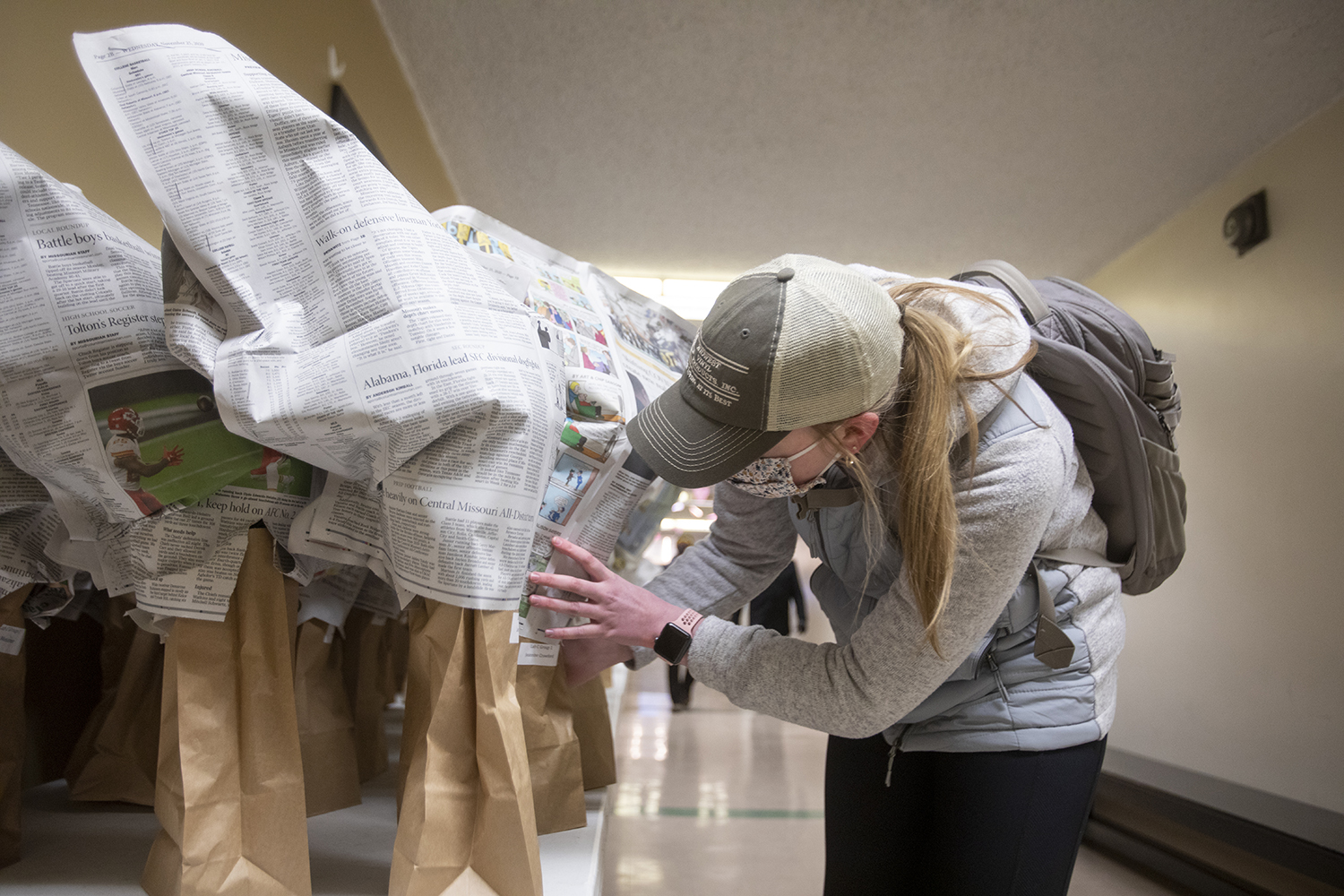 Chloe Sims, a freshman Animal Science major from Mexico, Missouri, searches for her pickup order outside Tiger Garden.