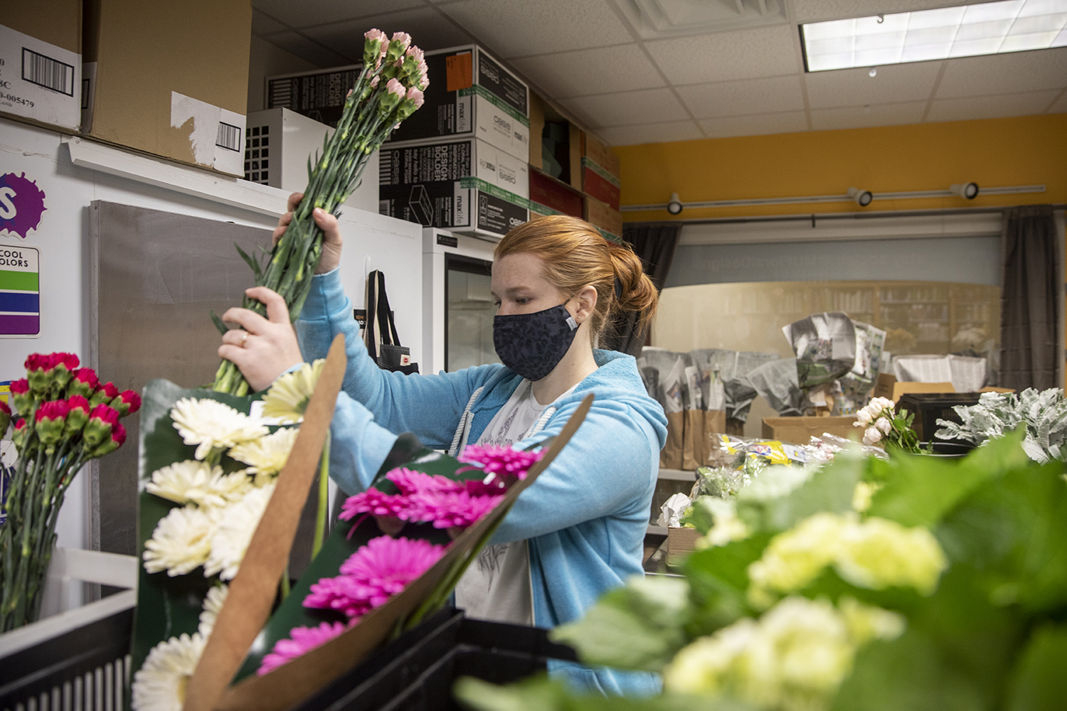 Elise Bailey, a senior agriculture student from Curryville, Missouri, organizes flower deliveries at Tiger Garden.