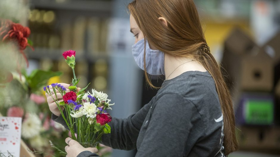 Amara Limberis, a junior Health Sciences major from Eden Prarie, Minnasota arranges flowers in a vase at Tiger Garden on Monday, Feb 8, 2021.