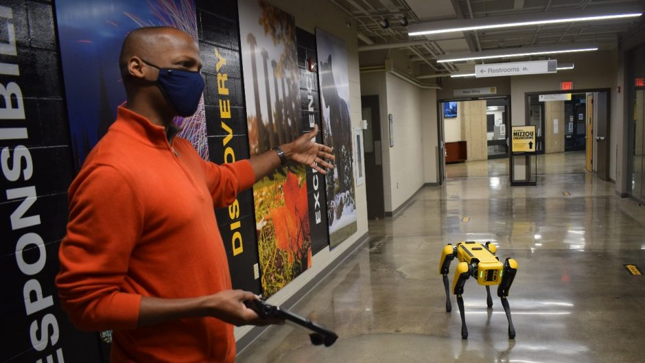 Kristofferson Culmer, who works in the College of Engineering's information technology program, demonstrates how to operate the robot by remote control.
