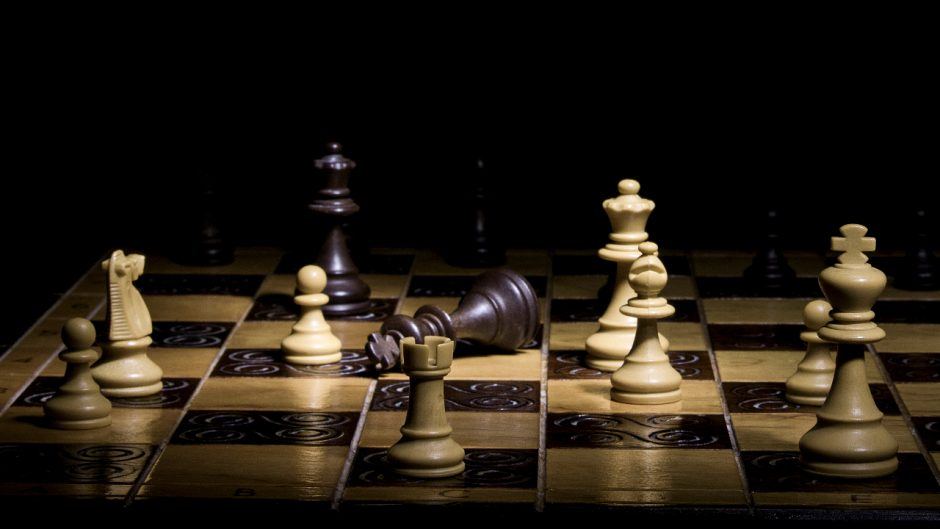 picture of chess pieces on a chess board