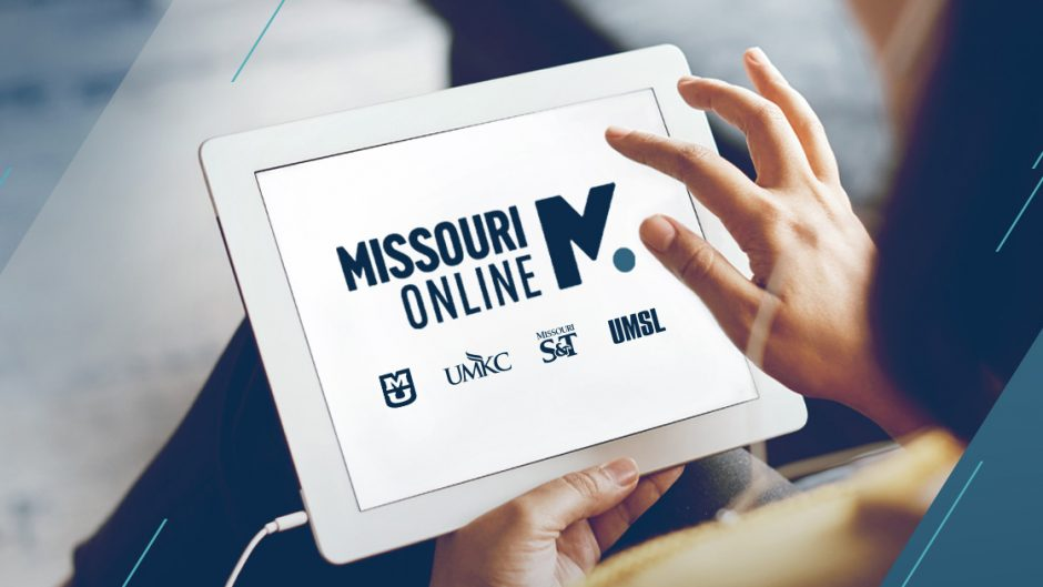 person tapping on an ipad that has a missouri online logo on the screen