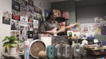 woman playing guitar in an office space