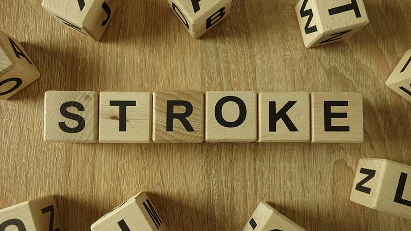 Stroke word from wooden blocks on desk