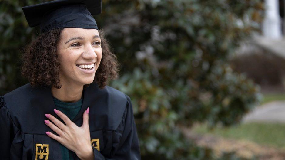 graduate in a cap, smiling