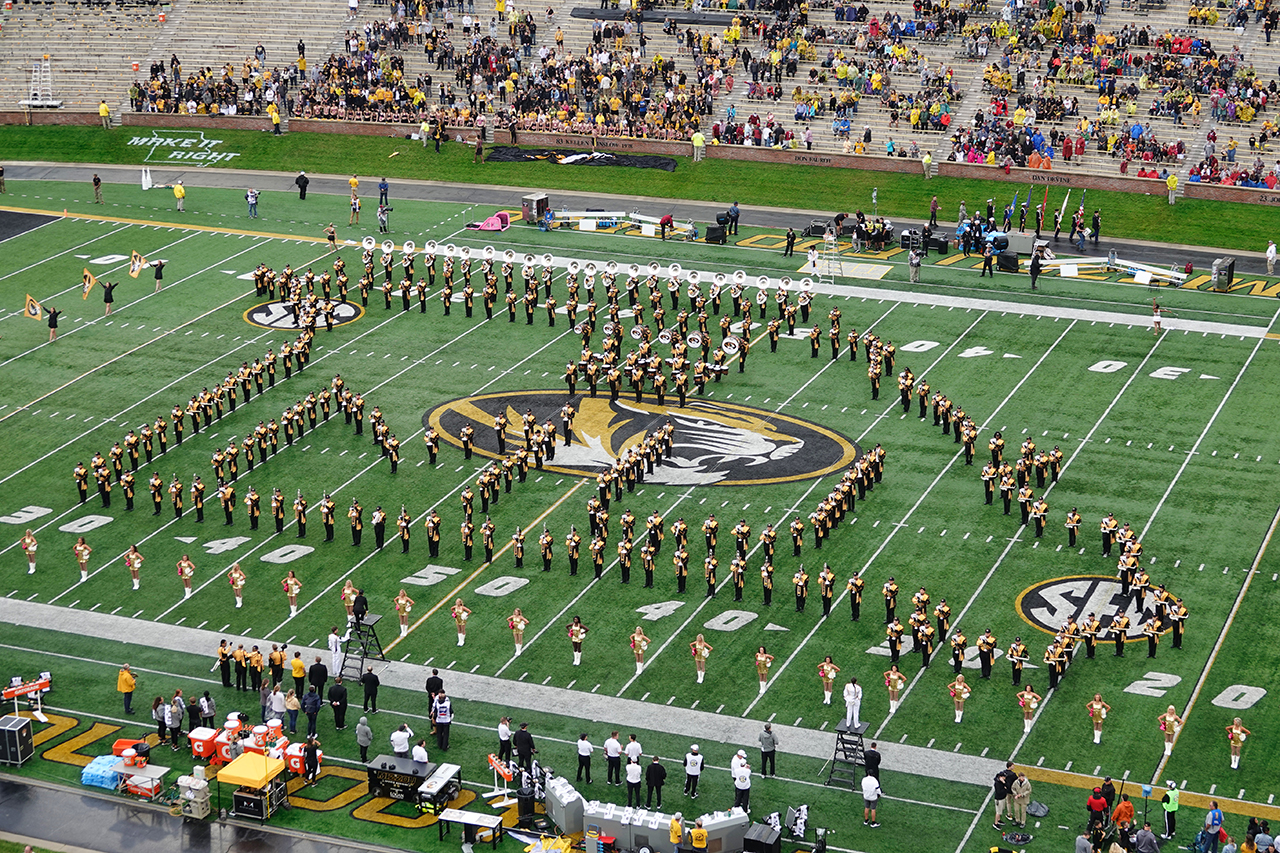 marching mizzou in the shape of missouri and spelling out MU on faurot field
