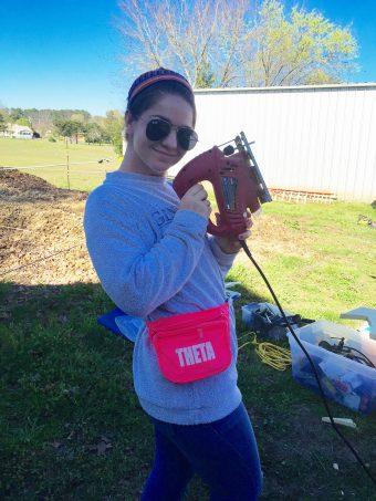 Lillie Heigl with a power tool