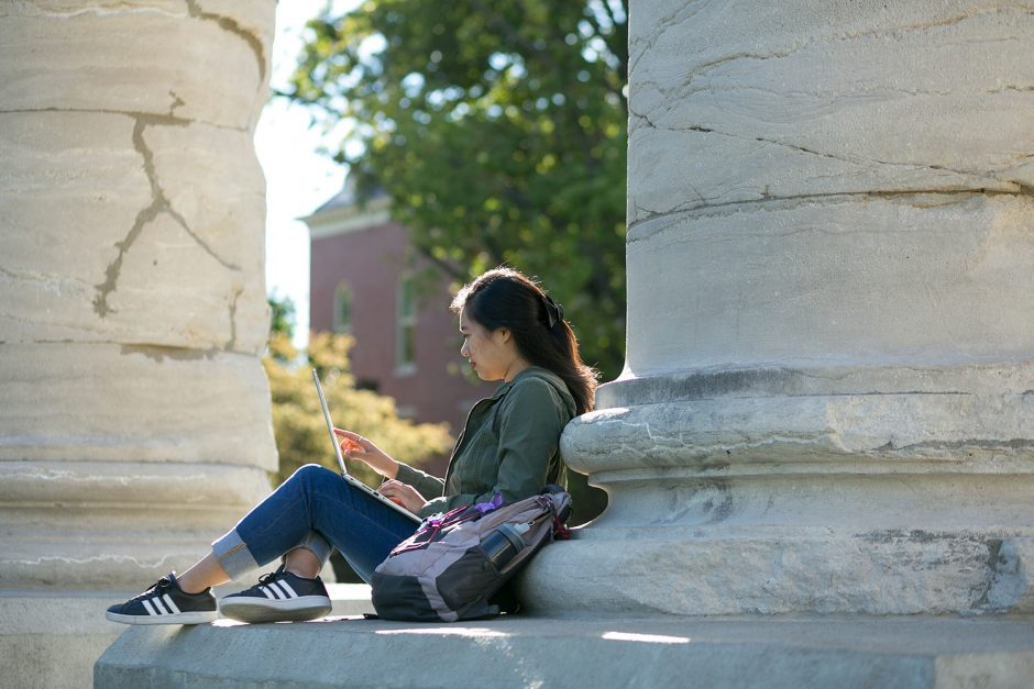 woman studying on the columns