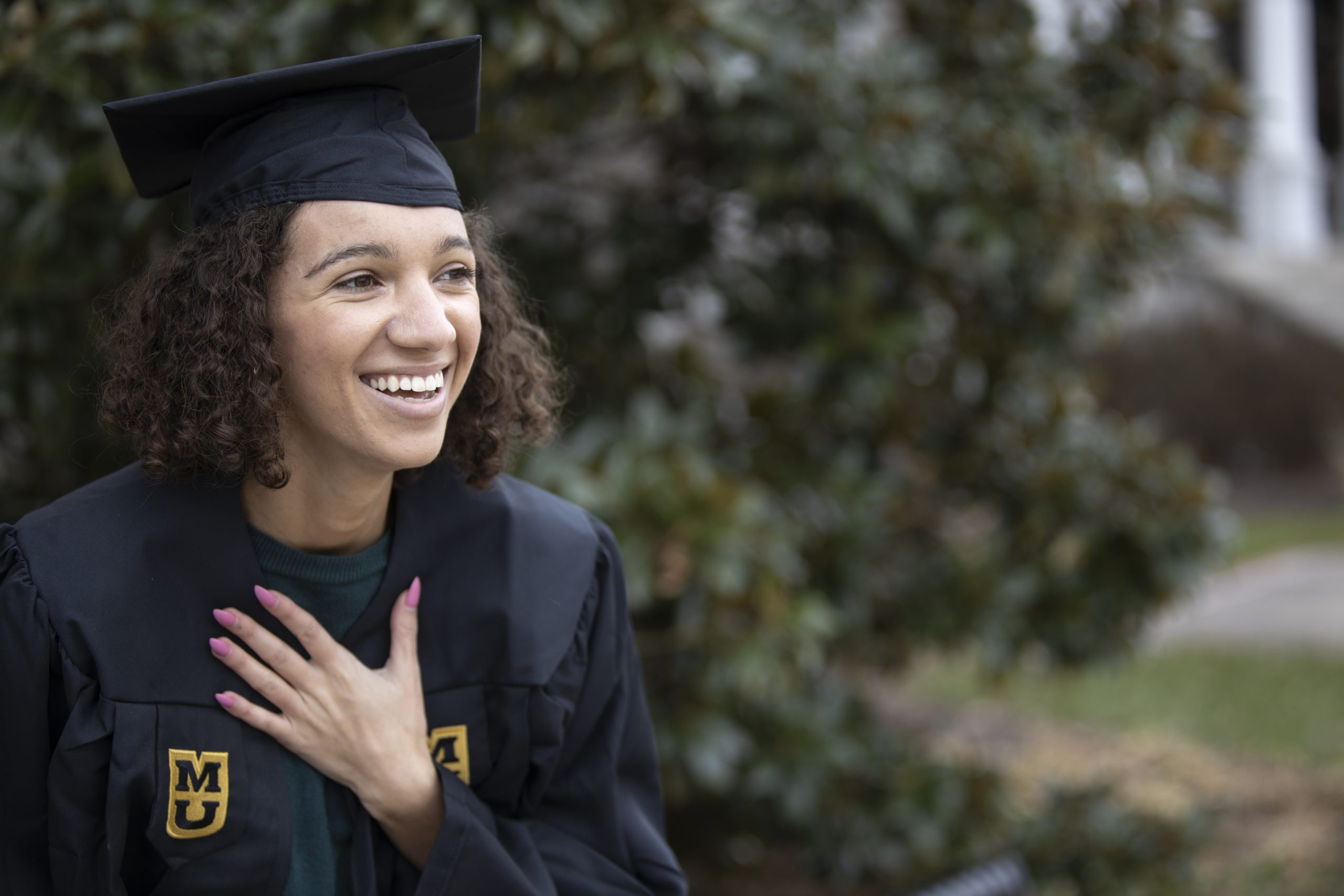 graduate smiling in a cap and gown