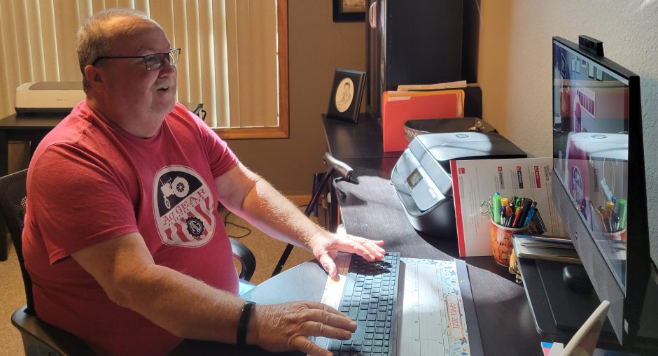 This is a photo of Chelsea Howland's dad using telehealth.