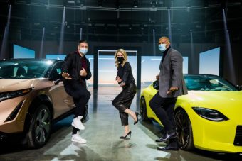 Allyson Witherspoon at a Nissan brand event alongside two former Heisman Trophy winners: Tim Tebow, left, and Eddie George.