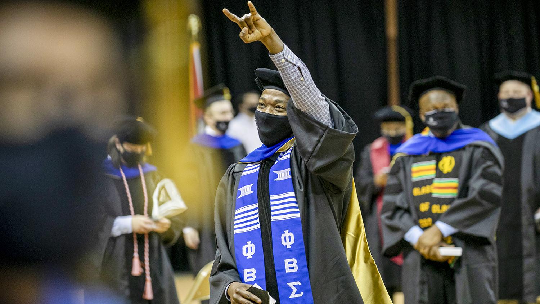man at graduation ceremony in regalia