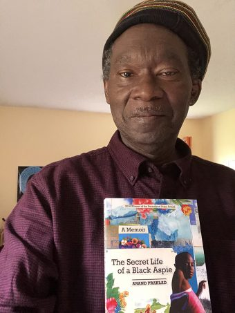 Anand Prahlad with his book