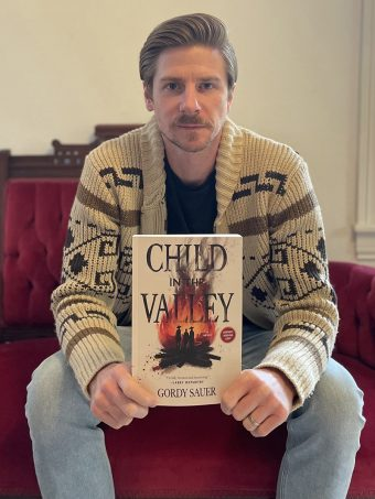 Gordy Sauer with his book