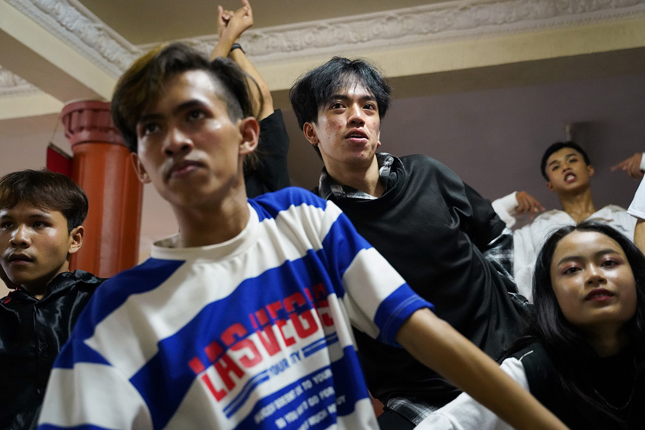 """Zing and members of his dance team """"The Bling"""" practice in a studio in Phnom Penh for an upcoming social media video. Since many of Zing's performances were canceled due to COVID-19, he has had more time to practice with his team. Photo by Cindy Liu"""