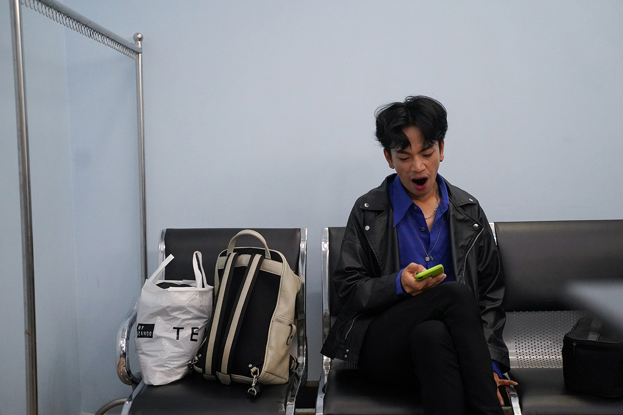 Zing rests in the make-up room after his performance at the Cambodian Television Network. Following the loss of performances during the pandemic, Zing hopes that he can return to dance full time. Photo by Cindy Liu