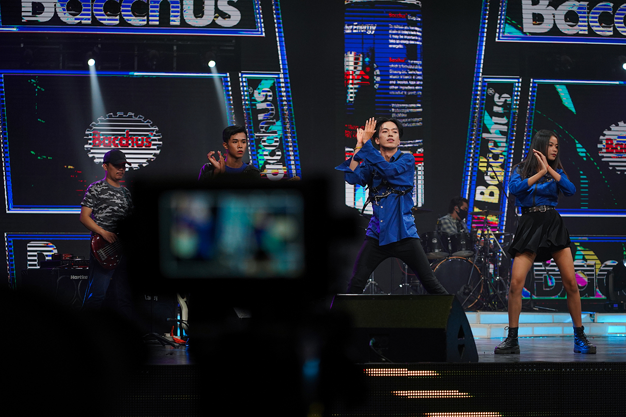 """Zing and some members of """"The Bling"""" perform with a singer at the Cambodian Television Network. """"When people see me dance I want them to be happy,"""" he said. """"I want to show them my talent."""" Photo by Cindy Liu"""