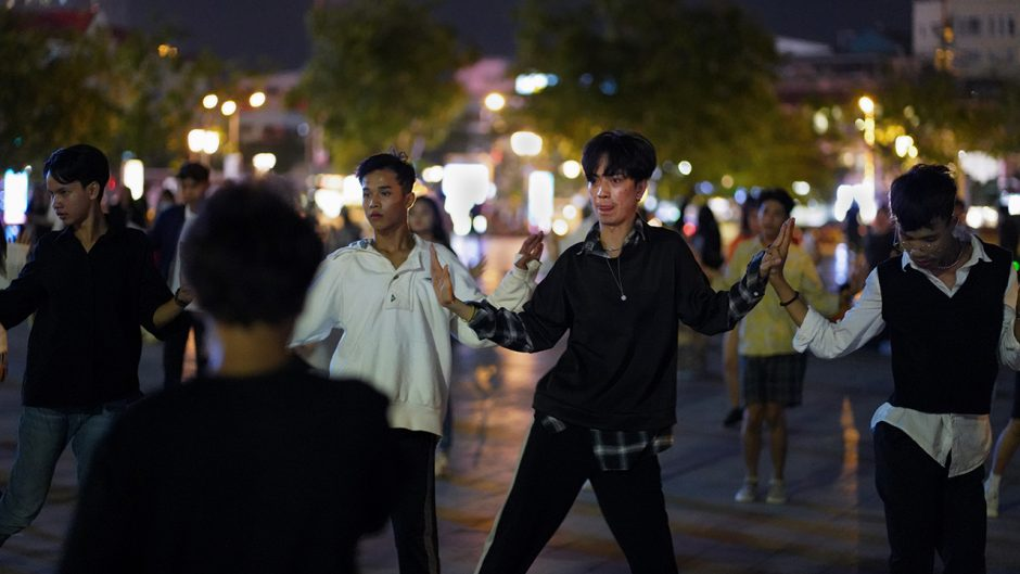 """Zing dances with his friends for two hours every evening in Phnom Penh's Wat Botum Park. """"I like to have a lot of people watch me dance, but I'm also shy,"""" Zing said. """"I can't look the audience in the eye."""" Photo by Cindy Liu"""
