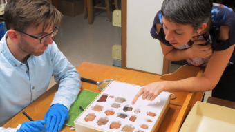 This is a photo of researchers looking at artifacts.