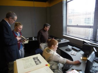This is a photo of researchers digitizing audio tapes.