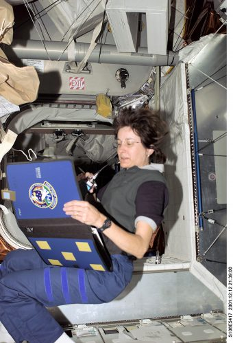 Godwin checks the master list inside the Multipurpose Logistics Module while docked to the International Space Station during the STS-108 space shuttle mission.