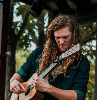 grady frazier playing a guitar