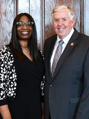 Robin Ransom and Gov. Parson smile for a photo