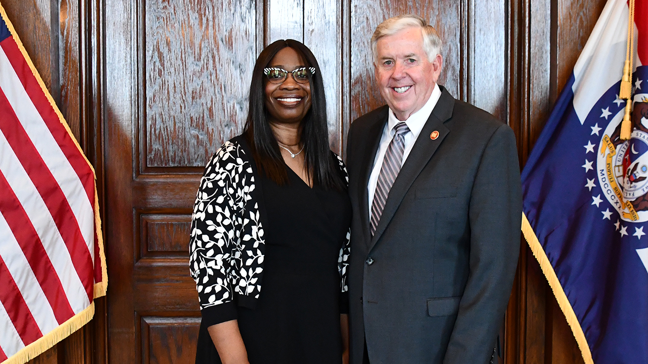 Ransome and Gov. Parson smile for a photo