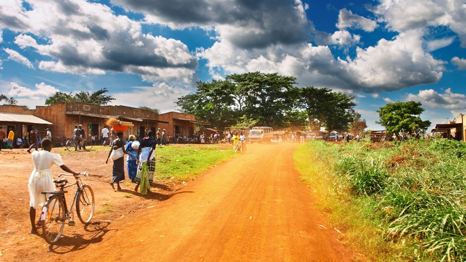 photo of an African countryside with people in the streets. Source: Shutterstock