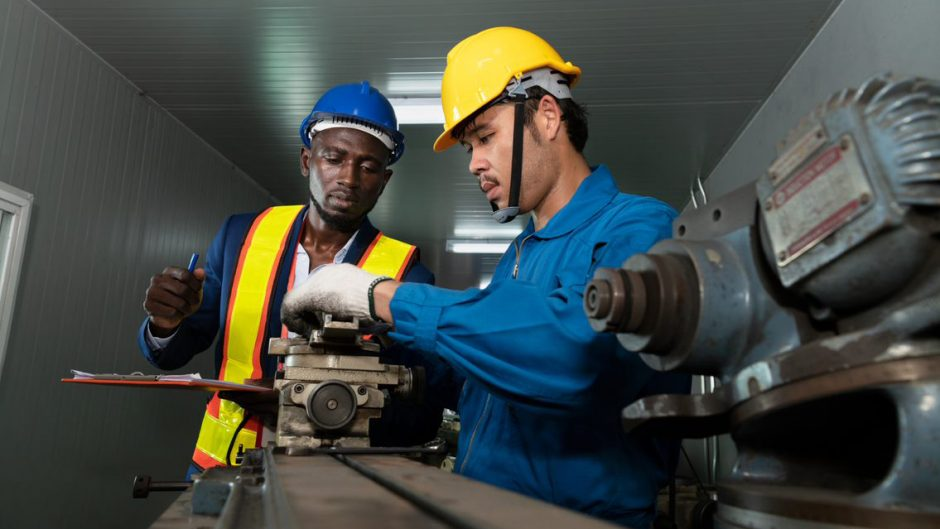 two men work in manufacturing