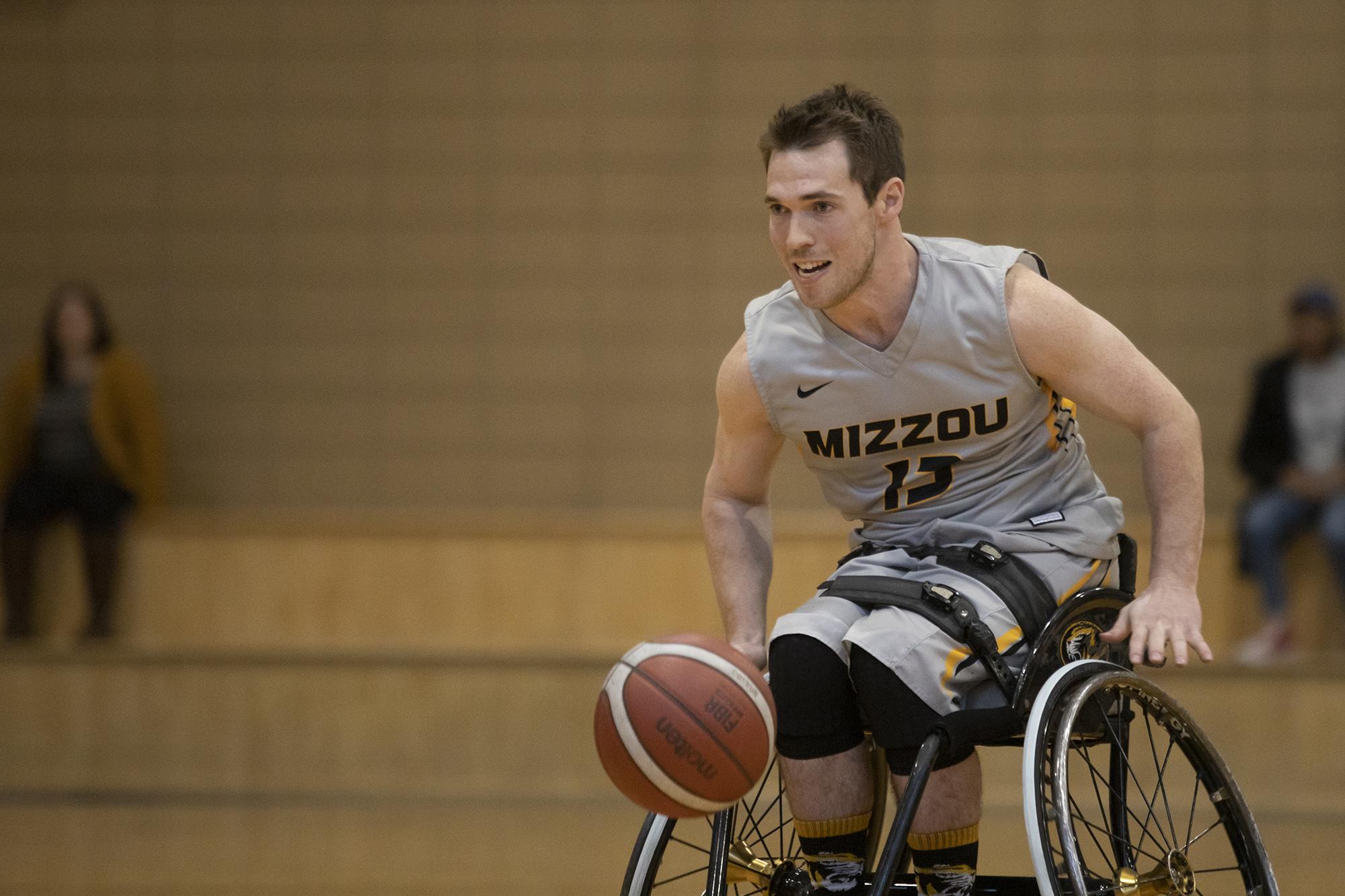 man playing wheelchair basketball