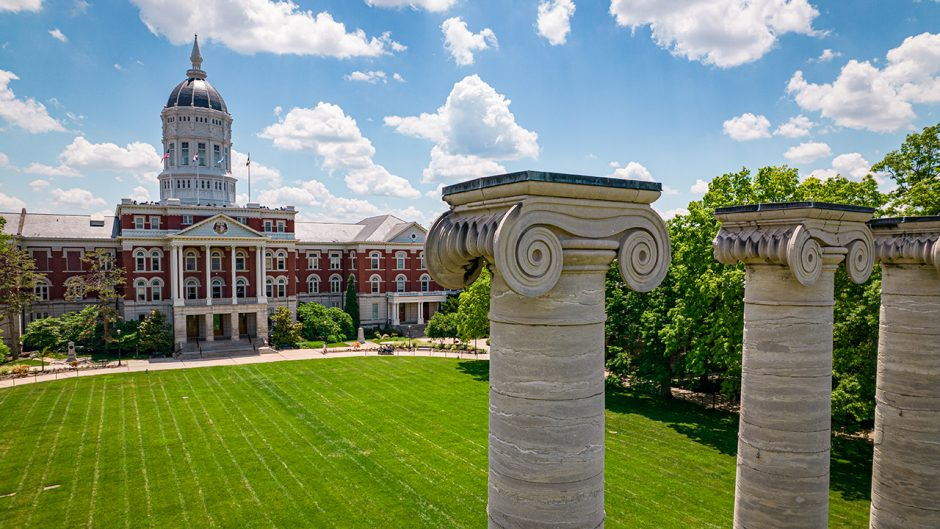 drone shot of jesse hall with the columns in detail on the right side of the photo