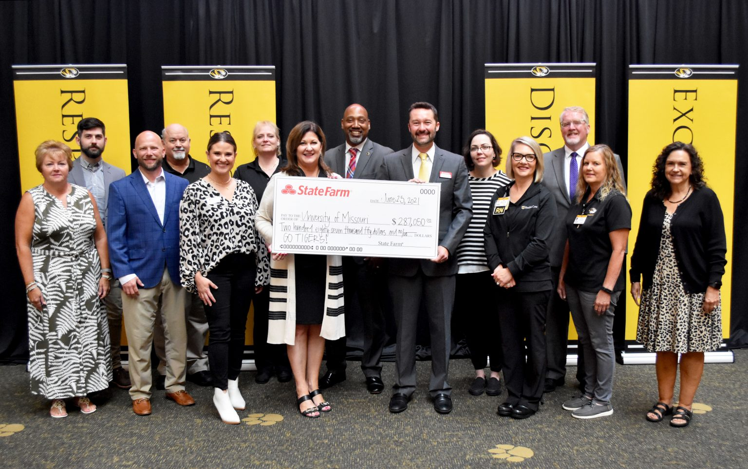 State Farm representatives presented a $287,050 gift to the University of Missouri for safety and financial wellness programs. See story for full caption.