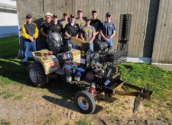 group of team members with their vehicle