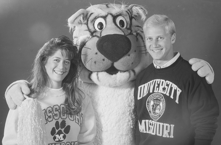 black and white photo of Truman the tiger and two students