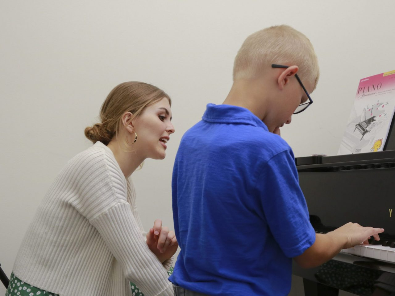 a teacher with a piano student