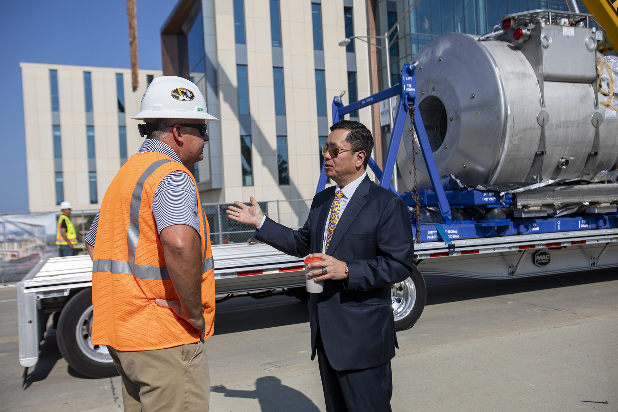 president choi and thomas spencer talk outside