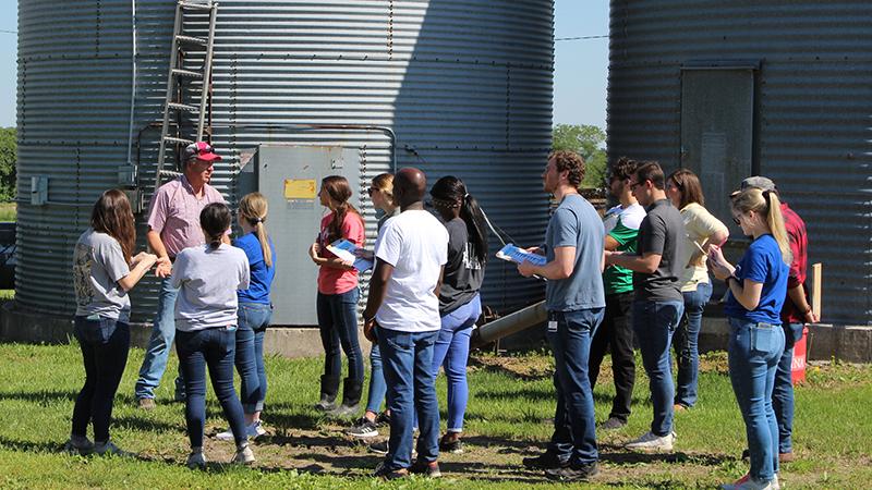 photo of students outside on a farm in sedalia