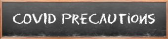 "chalkboard that says ""covid precautionss"""