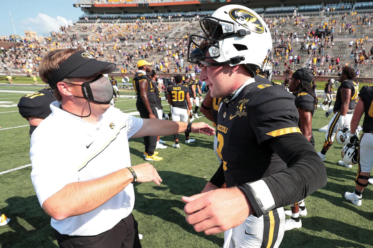 football coach and quarterback celebrating